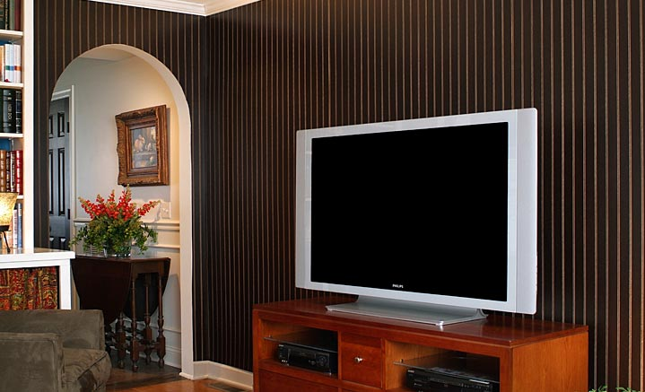 2 inch beaded black forest paneling in a mdeia room